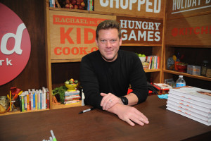 "NEW YORK, NY - OCTOBER 19:  Chef Tyler Florence signs copies of his book ""Fresh"" at the Grand Tasting presented by ShopRite featuring KitchenAid® culinary demonstrations presented by MasterCard during the New York City Wine & Food Festival at Pier 94 on October 19, 2014 in New York City.  (Photo by Bryan Bedder/Getty Images for NYCWFF) *** Local Caption *** Tyler Florence"
